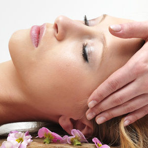 Reiki energy treatment on the head